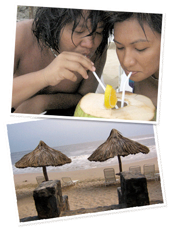 Gerry and Karina drink from a coconut